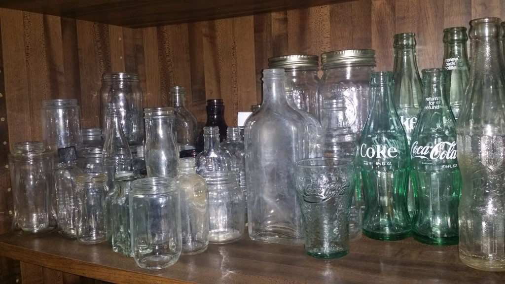 Vintage bottle collection by Flower Child Weddings