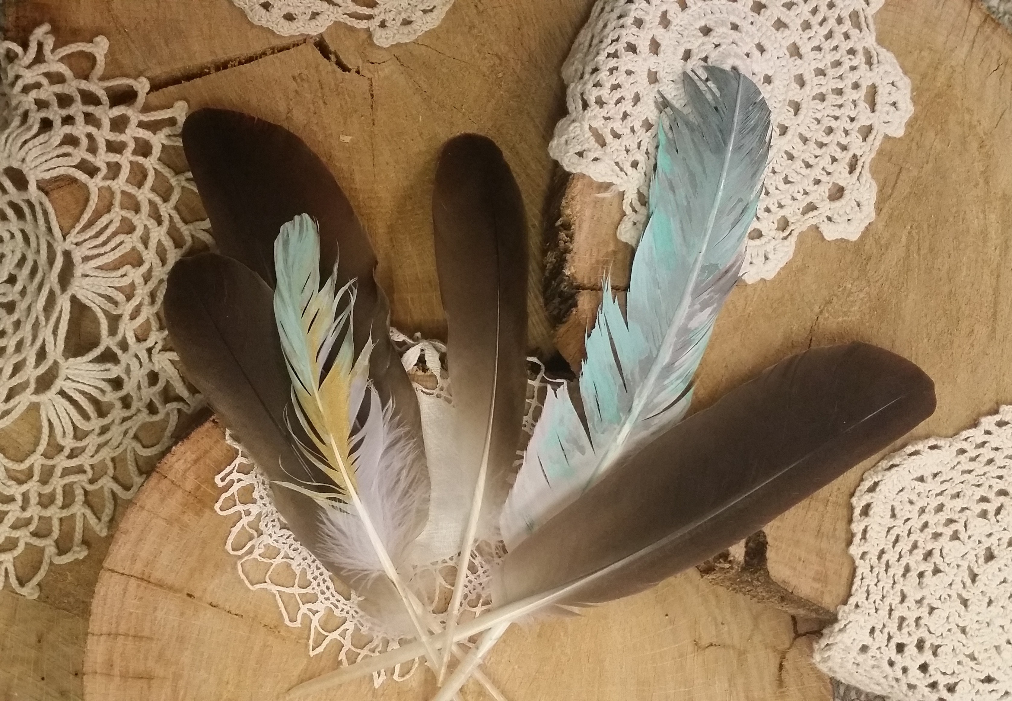 Hand painted feathers and doilies by Flower Child Weddings